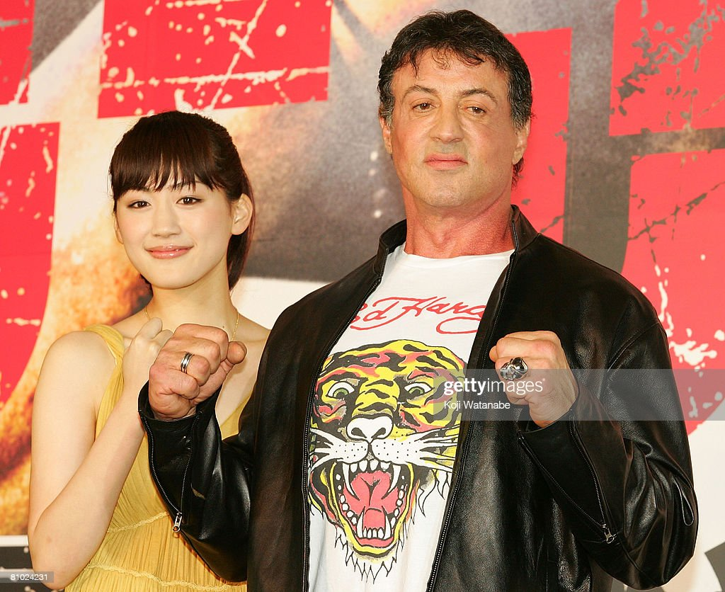 Actor Sylvester Stallone and Japanese actress Haruka Ayase pose for photographs during 'Rambo' Japan Premiere at Roppongi Hills on May 8, 2008 in Tokyo, Japan. The film will open on May 24 in Japan.