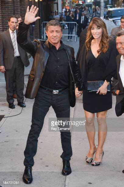Actor Sylvester Stallone and Jennifer Flavin enter the 'Late Show With David Letterman' taping at the Ed Sullivan Theater on October 15 2013 in New...