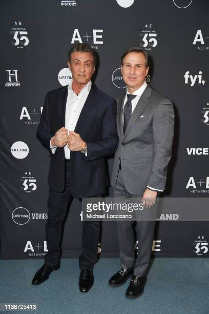 Actor Sylvester Stallone and President of A+E Networks Group Paul Buccieri attend the 2019 A+E Networks Upfront at Jazz at Lincoln Center on March...