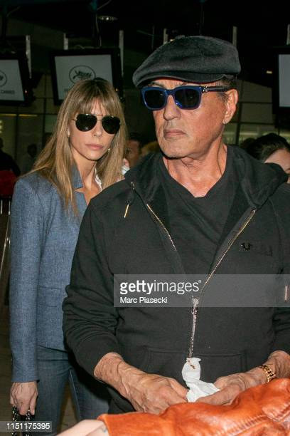 Actor Sylvester Stallone and wife Jennifer Flavin arrive ahead the 72nd annual Cannes Film Festival at Nice Airport on May 23 2019 in Nice France