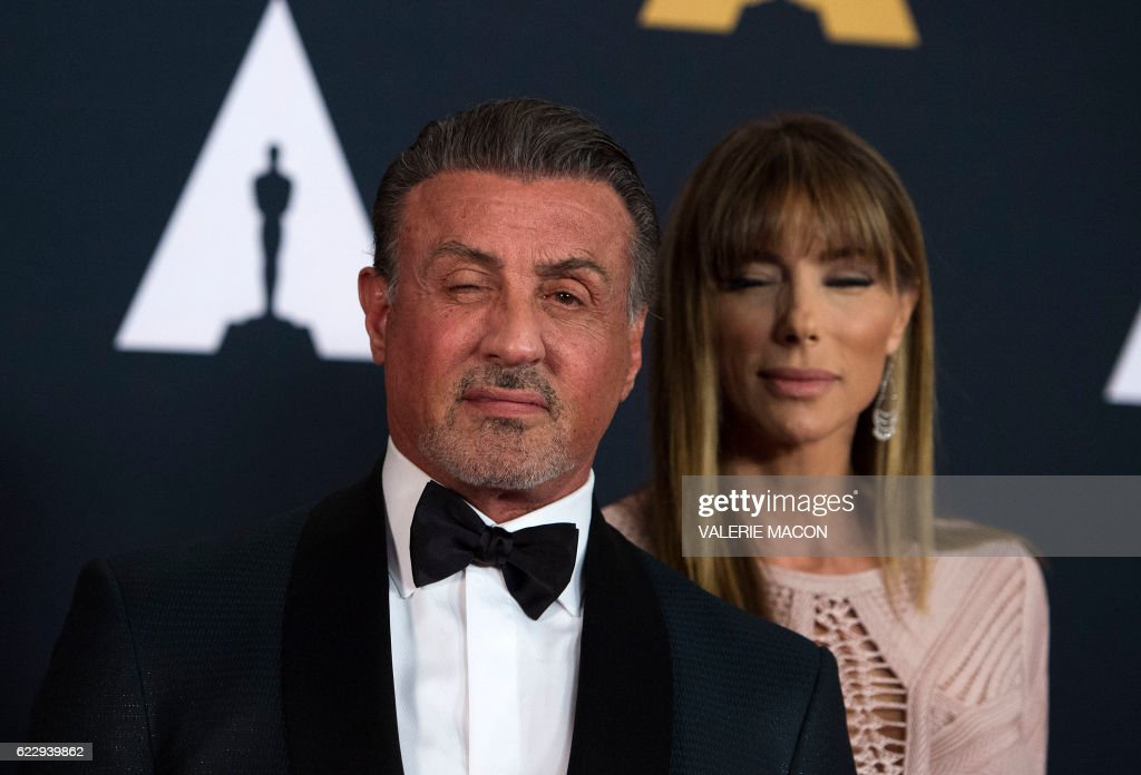 TOPSHOT - Actor Sylvester Stallone and wife Jennifer Flavin attend the 8th Annual Governors Awards hosted by the Academy of Motion Picture Arts and Sciences on November 12, 2016, at the Hollywood & Highland Center in Hollywood, California. The Academy's Board of Governors is presenting Honorary Oscar Awards to actor Jackie Chan, film editor Anne Coates, casting director Lynn Stalmaster and documentary filmaker Frederick Wiseman. / AFP / Valerie Macon