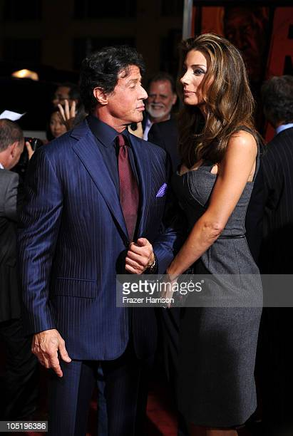 Actor Sylvester Stallone and wife Jennifer Flavina arrives at a special screening of Summit Entertainment's 'RED' at Grauman's Chinese Theatre on...