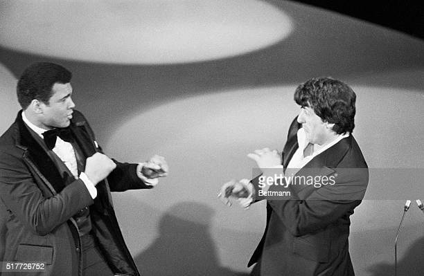 Actor Sylvester Stallone , and world heavyweight champion Muhammad Ali playfully square off on stage as Ali made a surprise appearance at the 49th...