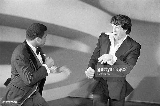 Actor Sylvester Stallone and world heavyweight champion Muhammad Ali playfully square off on stage as Ali made a surprise appearance at the 49th...