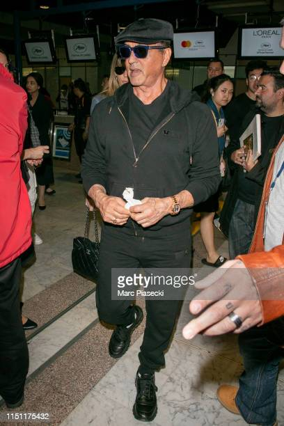 Actor Sylvester Stallone arrives ahead the 72nd annual Cannes Film Festival at Nice Airport on May 23 2019 in Nice France