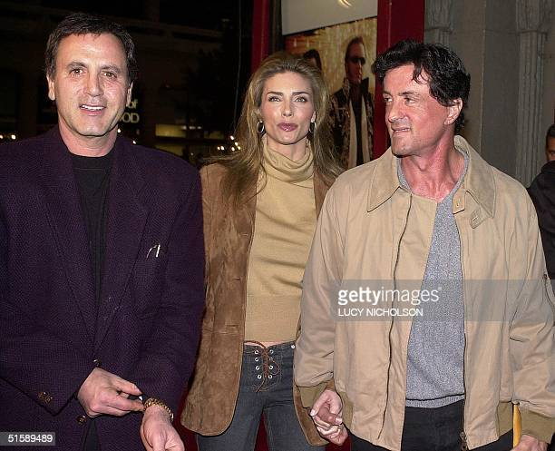 US actor Sylvester Stallone arrives at the premiere of the film 3000 Miles To Graceland with his wife Jennifer Flavin and his brother Frank Stallone...