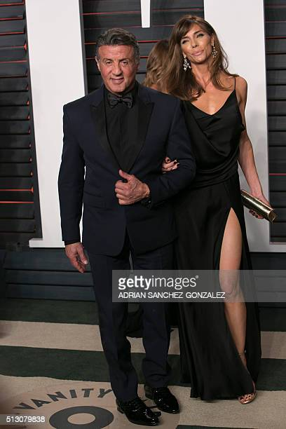 US actor Sylvester Stallone poses with his wife Jennifer Flavin as they arrive to the 2016 Vanity Fair Oscar Party in Beverly Hills California on...