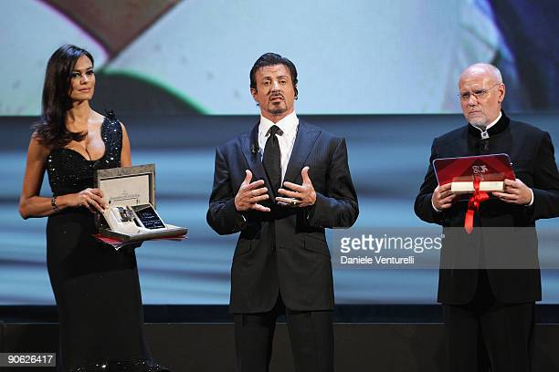 Actor Sylvester Stallone receives his Lifetime Achievement award from Festival director Marco Muller and Maria Grazia Cucinotta while attending the...