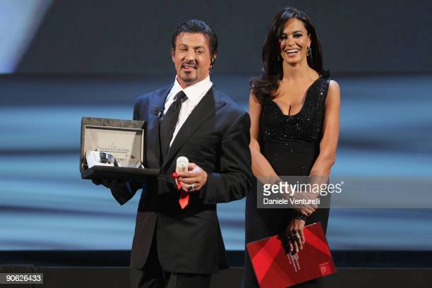 Actor Sylvester Stallone receives his Lifetime Achievement award from Maria Grazia Cucinotta while attending the Closing Ceremony at the Sala Grande...
