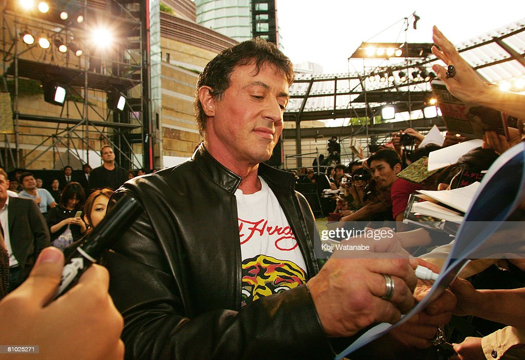 Actor Sylvester Stallone signs autographs as he walks the red carpet during 'Rambo' Japan Premiere at Roppongi Hills May 8, 2008 in Tokyo, Japan. The film will open on May 24 in Japan.