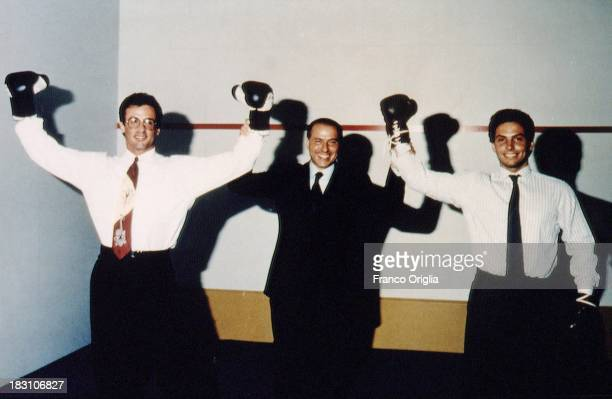 Actor Sylvester Stallone Silvio Berlusconi and his son Pier Silvio Berlusconi wearing boxing gloves in 1993 in Milan Italy