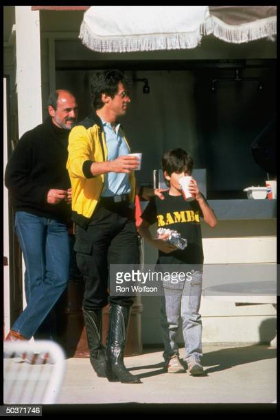 Actor Sylvester Stallone w son Sage outside