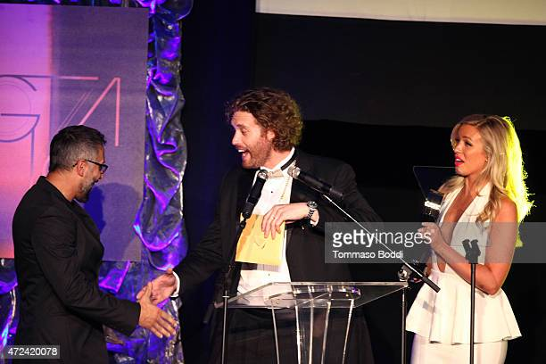 Actor T J Miller honors producer Ben Andron with the Don LaFontaine Award for Best Voice Over Golden Trailer Award on behalf of the crew on stage at...