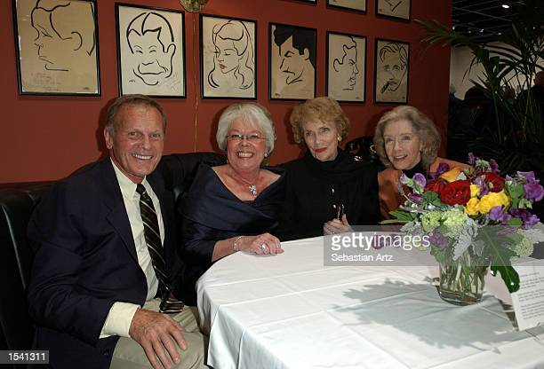 Actor Tab Hunter restauranteur Peggy Cobb Walsh actresses Joan Leslie and Marsha Hunt pose in a replica of an original restaurant booth at the...