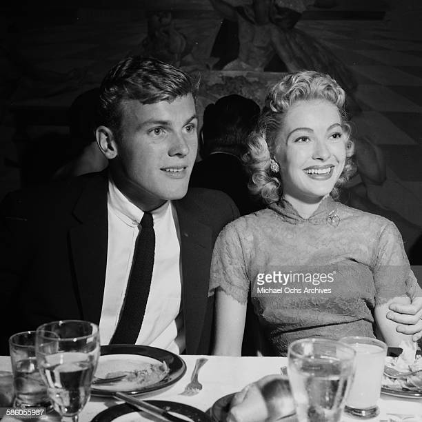 Actor Tab Hunter with Lori Nelson attend a party in Los Angeles California