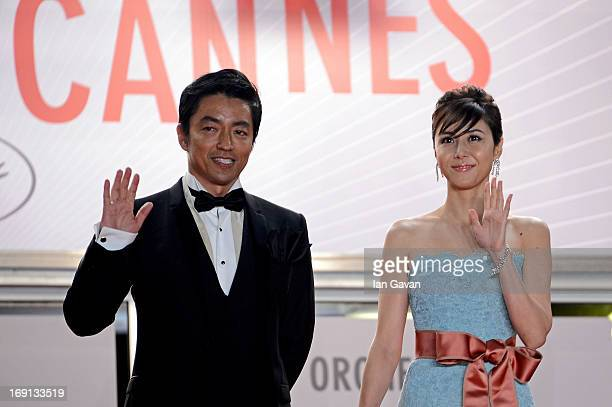 Actor Takashi Miike and actress Nanako Matsushima attend the 'Wara No Tate' Premiere during the 66th Annual Cannes Film Festival at the Palais des...