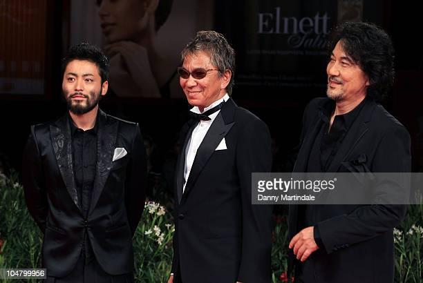 Actor Takayuki Yamada director Takashi Miike and actor Koji Yakusho attend the '13 Assassins' premiere at the Palazzo del Cinema during the 67th...