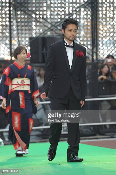 Actor Takayuki Yamada walks on the green carpet during the Tokyo International Film Festival Opening Ceremony at Roppongi Hills on October 22 2011 in...
