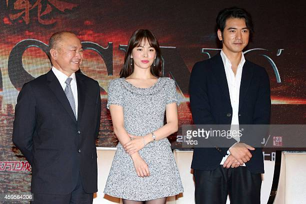 Actor Takeshi Kaneshiro actress Song Hye Kyo and director John Woo attend press conference of movie 'The Crossing' on November 25 2014 in Shanghai...