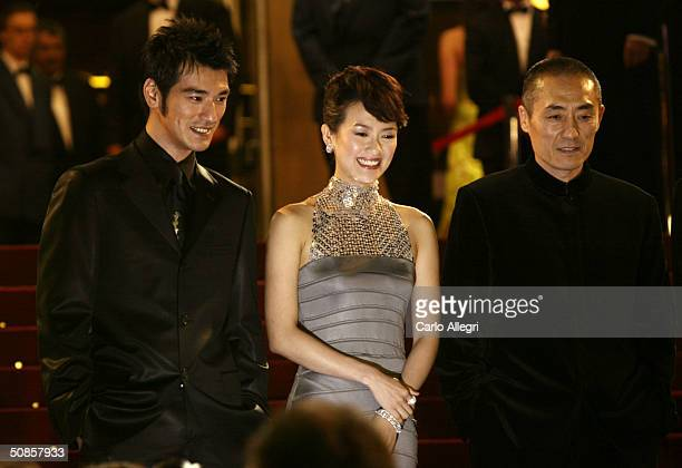 Actor Takeshi Kaneshiro actress Ziyi Zhang and director Yimou Zhang attend the premiere of 'House of Flying Daggers' atthe Palais de Festival during...