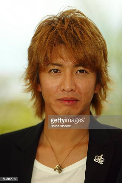 Actor Takuya Kimura attends '2046' photocall at Le Palais de Festival at the 57th Cannes Film Festival on May 21 2004 in Cannes France