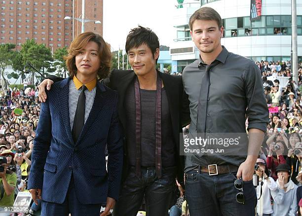 Actor Takuya Kimura Lee ByungHun and Josh Hartnett attend the open talk 'I Come with the Rain' during the 14th Pusan International Film Festival at...