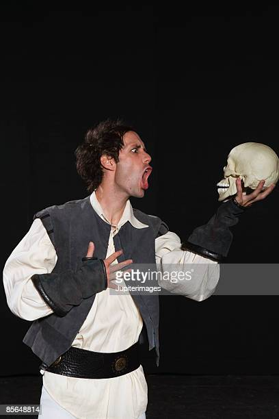 Actor talking to skull