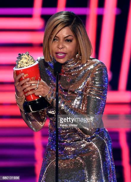 Actor Taraji P Henson accepts the Best Fight Against The System award for 'Hidden Figures' onstage during the 2017 MTV Movie And TV Awards at The...