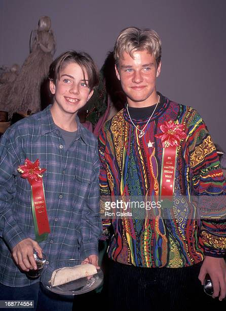 Actor Taran Noah Smith and actor Zachery Ty Bryan attend the 65th Annual Hollywood Christmas Parade on December 1 1996 at KTLA Studios in Hollywood...