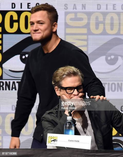 Actor Taron Egerton walks onstage behind actor Colin Firth at the 20th Century FOX panel during ComicCon International 2017 at San Diego Convention...