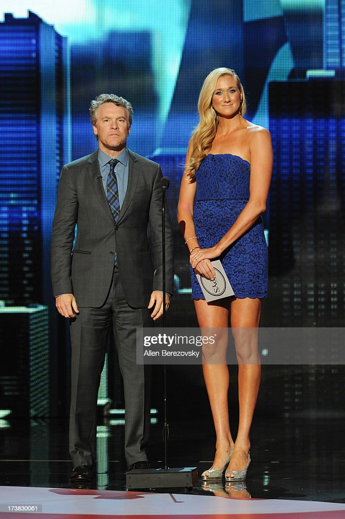 Actor Tate Donovan and volleyball player Kerri Walsh Jennings presenting for Best Moment onstage at the 2013 ESPY Awards at Nokia Theatre L.A. Live on July 17, 2013 in Los Angeles, California.