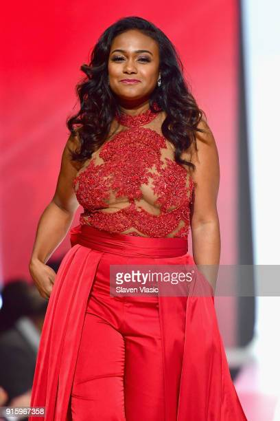 Actor Tatyana Ali walks the runway during the American Heart Association's Go Red For Women Red Dress Collection 2018 presented by Macy's at...