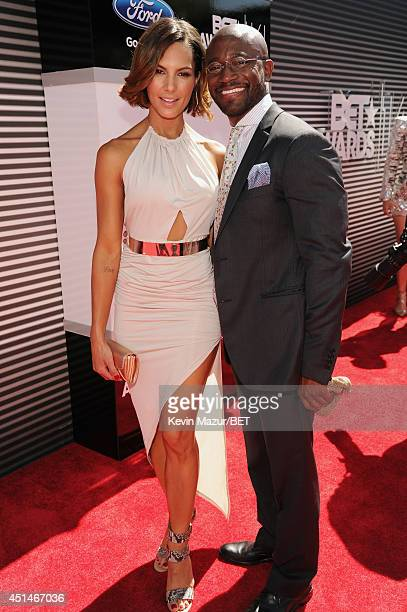 Actor Taye Diggs and guest attend the BET AWARDS '14 at Nokia Theatre LA LIVE on June 29 2014 in Los Angeles California