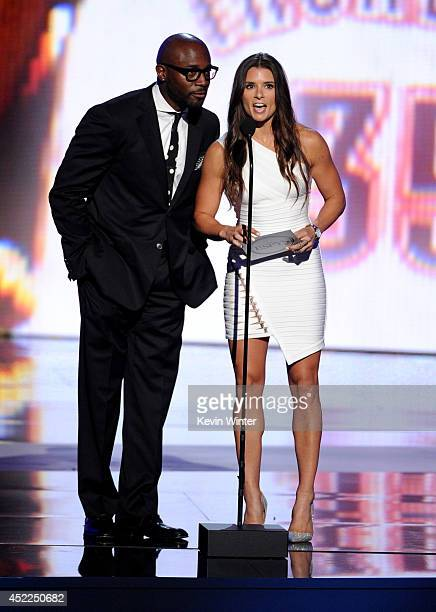 Actor Taye Diggs and NASCAR driver Danica Patrick speak onstage during the 2014 ESPYS at Nokia Theatre LA Live on July 16 2014 in Los Angeles...