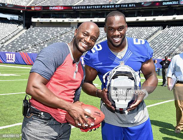 Actor Taye Diggs and professional football player Jonathan Beason attend a Duracell interactive tour of MetLife Stadium on August 27, 2014 in East...