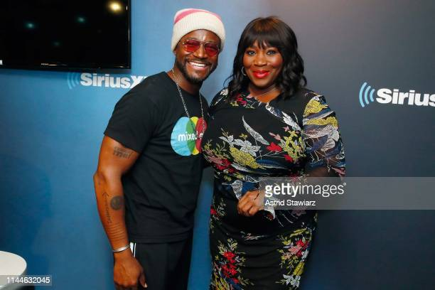 Actor Taye Diggs and SiriusXm host Bevy Smith pose for photos during a taping of 'Bevelations' on SiriusXM's Radio Andy at the SiriusXM Studios on...
