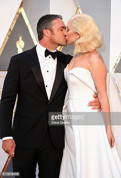 Actor Taylor Kinney and ecording artist Lady Gaga attend the 88th Annual Academy Awards at Hollywood Highland Center on February 28 2016 in Hollywood...