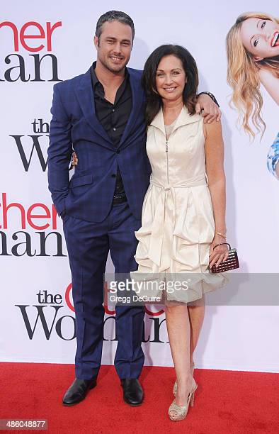 Actor Taylor Kinney and mom Pamela Heisler arrive at the Los Angeles premiere of 'The Other Woman' at Regency Village Theatre on April 21 2014 in...