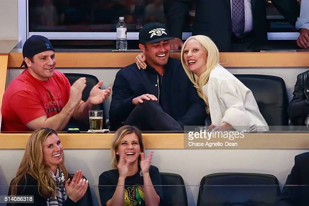 Actor Taylor Kinney and musician Lady Gaga enjoy watching the NHL game between the Chicago Blackhawks and the Detroit Red Wings at the United Center...