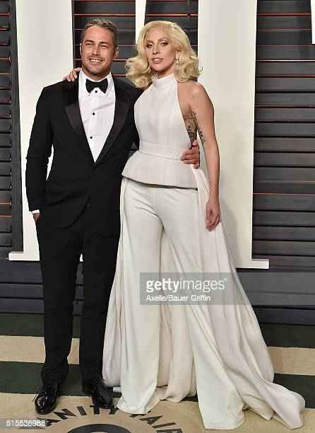 Actor Taylor Kinney and recording artist Lady Gaga arrive at the 2016 Vanity Fair Oscar Party Hosted By Graydon Carter at Wallis Annenberg Center for...