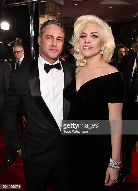 Actor Taylor Kinney and recording artist Lady Gaga attend the 73rd Annual Golden Globe Awards at The Beverly Hilton Hotel on January 10 2016 in...
