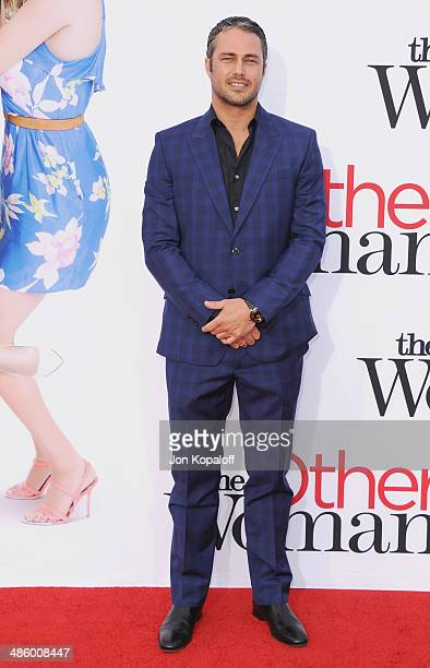 Actor Taylor Kinney arrives at the Los Angeles Premiere 'The Other Woman' at Regency Village Theatre on April 21 2014 in Westwood California
