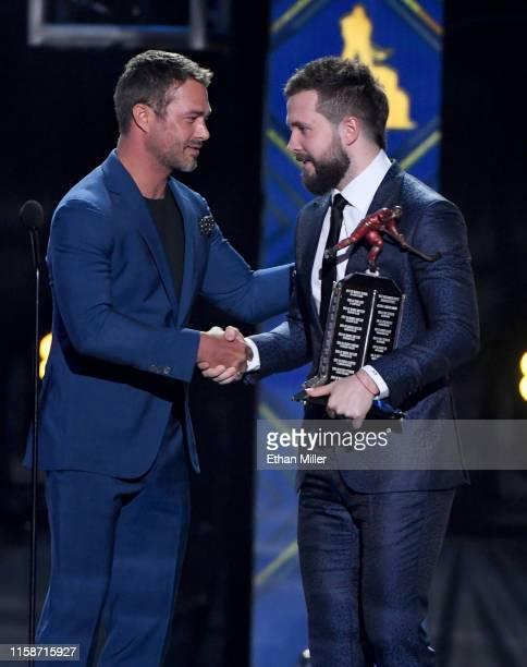 Actor Taylor Kinney presents the Ted Lindsay Award to Nikita Kucherov of the Tampa Bay Lightning during the 2019 NHL Awards at the Mandalay Bay...
