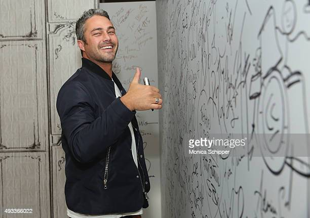 """Actor Taylor Kinney signs the wall at AOL Studios when he visits for AOL Build Presents """"Rock The Kasbah"""" at AOL Studios In New York on October 19,..."""