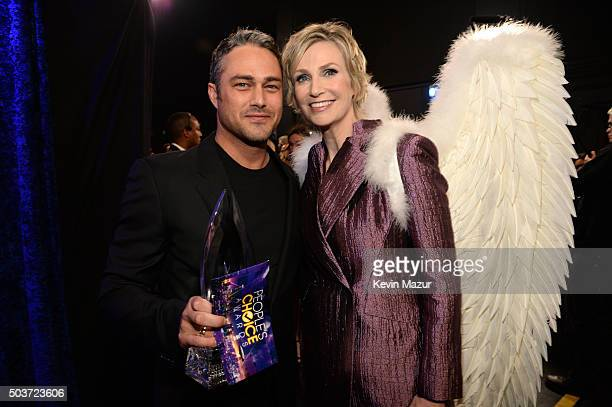 Actor Taylor Kinney winner of Favorite Dramatic TV Actor award poses with host Jane Lynch at the People's Choice Awards 2016 at Microsoft Theater on...