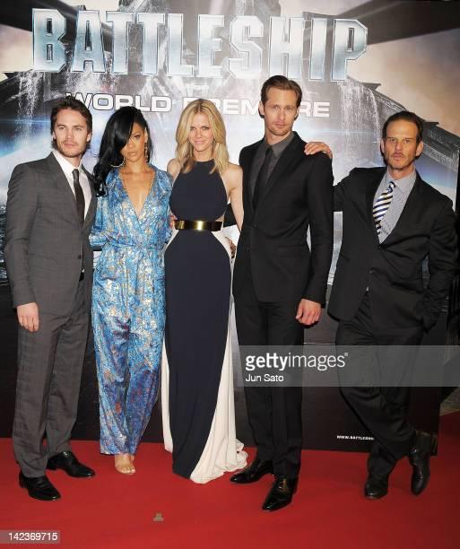 Actor Taylor Kitsch actresses Rihanna Brooklyn Decker actor Alexander Skarsgard and director Peter Burg attend the 'Battleship' World premier at...