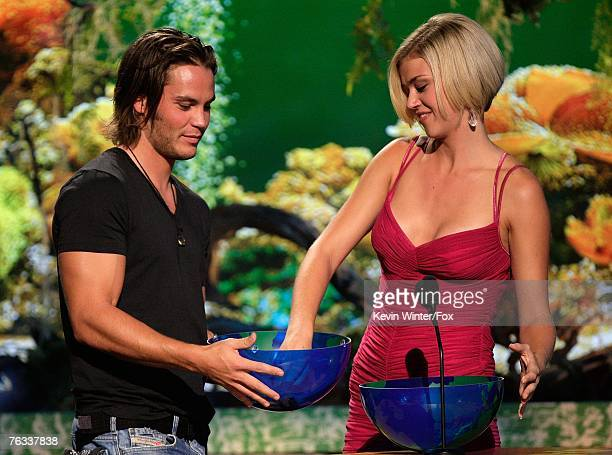 Actor Taylor Kitsch and actress Adrianne Palicki present the 'Choice TV Actress Comedy' award onstage during the 2007 Teen Choice Awards held at The...