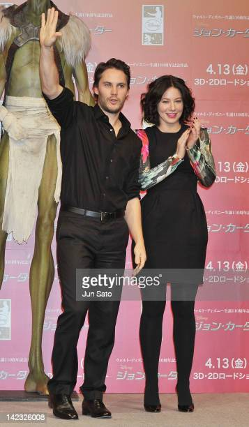 Actor Taylor Kitsch and actress Lynn Collins attend the 'John Carter' Press Conference at the Ritz Carlton Tokyo on April 2 2012 in Tokyo Japan The...