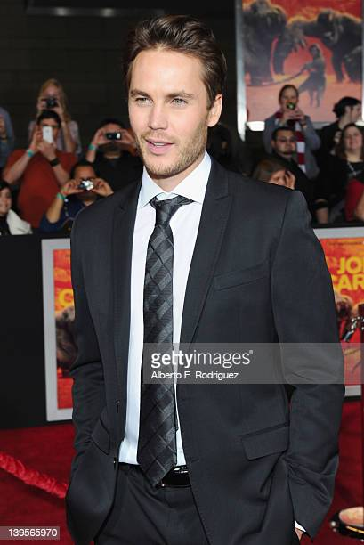 """Actor Taylor Kitsch arrives at the Walt Disney Presents """"John Carter"""" premiere held at Regal Cinemas L.A. Live on February 22, 2012 in Los Angeles,..."""