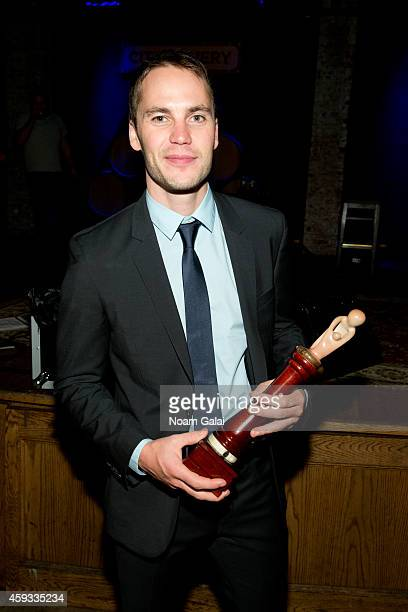 Actor Taylor Kitsch poses with his ChangeMakers Award during the 6th Annual African Children's Choir Changemakers Gala at City Winery on November 20...